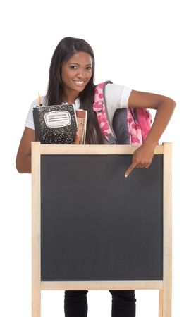 brunnet: education series template - Friendly ethnic black woman high school student by chalkboard