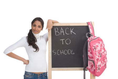 Friendly Indian college student woman with backpack by chalkboard photo