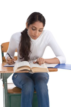 english ethnicity: English spelling-bee contest education series - ethnic Indian female high school student studying dictionary preparing for test, exam or spelling bee contest Stock Photo