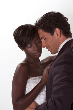 romantic newlywed young ethnic black African American woman and mid aged Caucasian man Standard-Bild