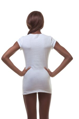 Young female beauty ethnic fashion model of African-American ethnicity wearing just white t-shirt and high heels only and otherwise nude photo