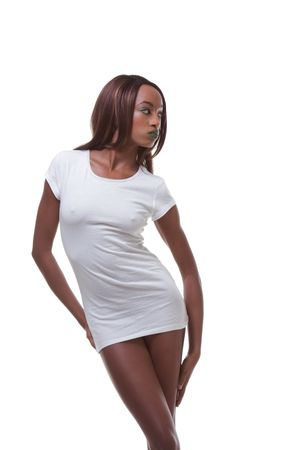 Young female beauty ethnic fashion model of African-American ethnicity wearing just white t-shirt only and otherwise nude Standard-Bild