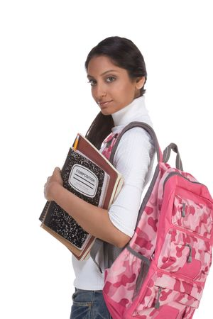 16 19 years: education series - Friendly ethnic Indian female high school student with backpack and composition book Stock Photo