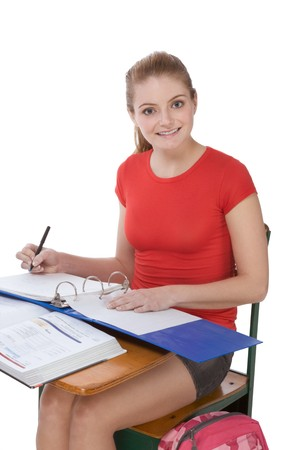 High school or college female student sitting by the desk doing her math homework Stock Photo - 6925589