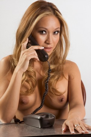 Naked woman with phone. The image illustrates concept of phone sex. Stock Photo - 6925711