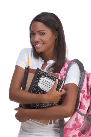 education series - Friendly ethnic black female high school student with backpack and composition book photo