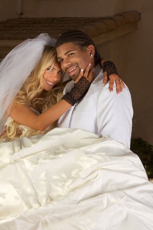 Interracial couple outdoors. Smiling laughing newlywed young Caucasian woman and mid aged ethnic black man of African American and Italian ethnicity photo