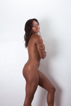 african american nude: Nude mulatto biracial female mix of black African American, Native American and German ethnicity standing by wall