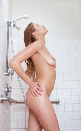 Gorgeous nude female in shower photo