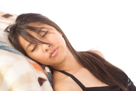Asian young woman lying down with eyes closed photo