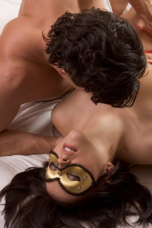 Seductive woman with lover wearing mystery fetish mask Stock Photo - 8407053