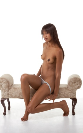 Sensual black ethnic biracial (mix of African-American, Caucasian and Native American ethnicity) woman stripper undressing