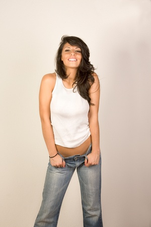 Attractive sensual girl in jeans and tank top