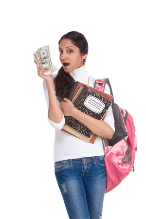 Ethnic Indian college student with compositions notebook, copybooks and backpack holds pile 100 (one hundred) dollar bills happy getting money help to subsidies costly university cost photo