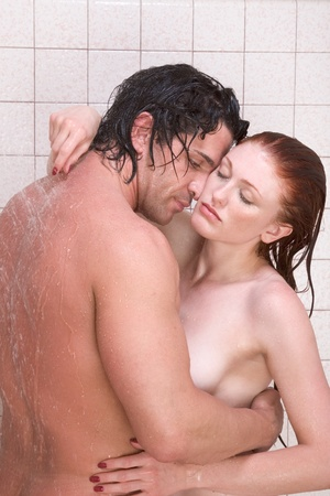 Loving affectionate nude young heterosexual couple in affectionate sensual kiss after taking shower. Mid adult Caucasian men in late 30s and young Caucasian redhead woman in early 20s Stock Photo - 8530650