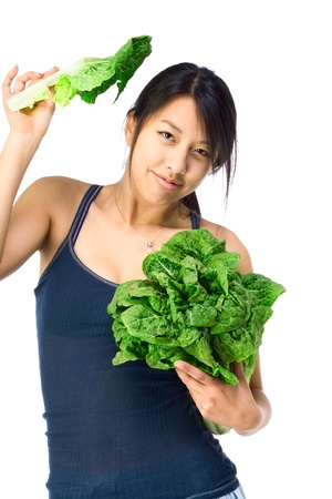 Chinese female presenting lettuce holding in hands photo