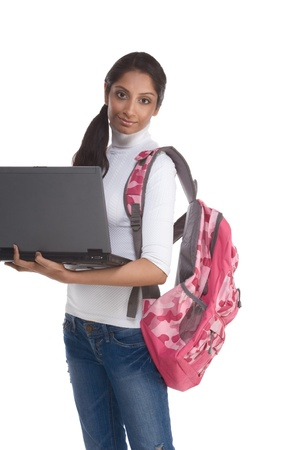 education series template - Friendly ethnic Indian woman high school student typing on portable computer Stock Photo - 8552783