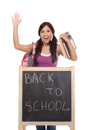school bag: education series - Friendly ethnic Hispanic woman high school student by chalkboard