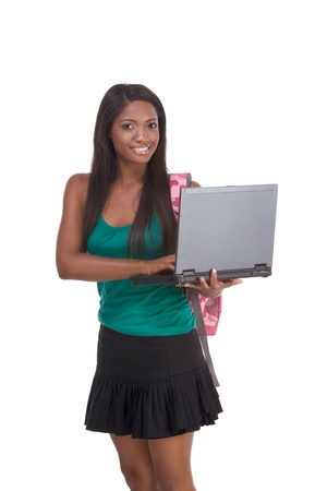 education series template - Friendly ethnic black woman high school student typing on portable computer Stock Photo - 8659976