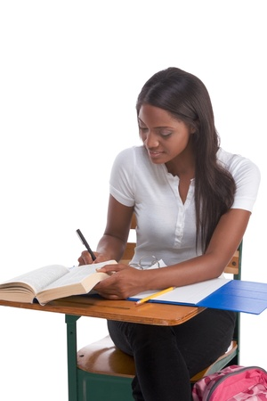 English spelling-bee contest education series - ethnic black female high school student studying dictionary preparing for test, exam or spelling bee contest Standard-Bild