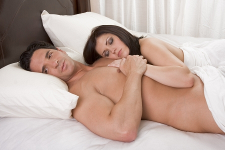 Young sexy naked heterosexual couple in love sleeping in bed Stock Photo - 8962482