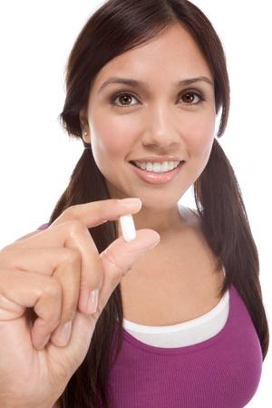 Tableta de medicación blanco joven Latina mujer mostrando Foto de archivo - 8962483