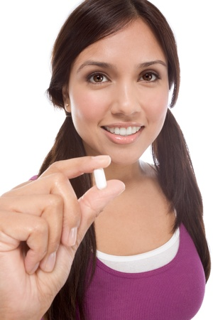Young Latina woman showing white medication tablet Stock Photo - 8962483