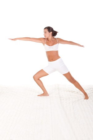 sport clothes: yoga pose - female in sport clothes performing exercise Stock Photo