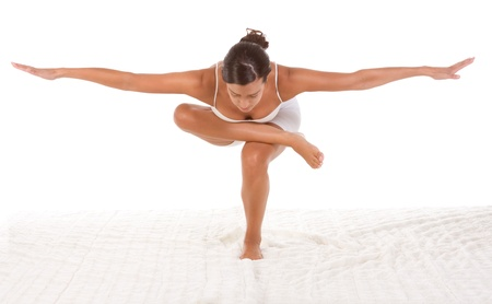 sport clothes: yoga pose StandingSquatting pigeon - female in sport clothes performing exercise
