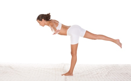 yoga pose Warrior III (airplane) - female in sport clothes performing exercise photo