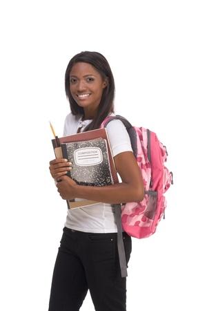 brunnet: serie de educaci�n - amistoso �tnicos negro femenina estudiante de secundaria con libro de mochila y composici�n Foto de archivo