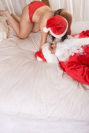 Young sexy woman having sex with Santa Claus Stock Photo - 9165186