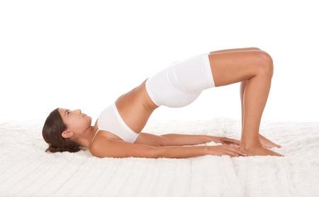 sport clothes: yoga pose Bridge - female in sport clothes performing exercise