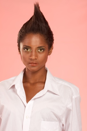 ethnic mix of Afro-American and Indian woman in white shirt photo