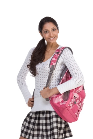 16 19 years: education series - Friendly ethnic Indian female high school student with backpack