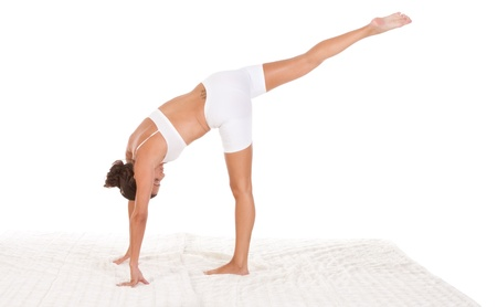 yoga pose Half-Moon - female in sport clothes performing exercise photo