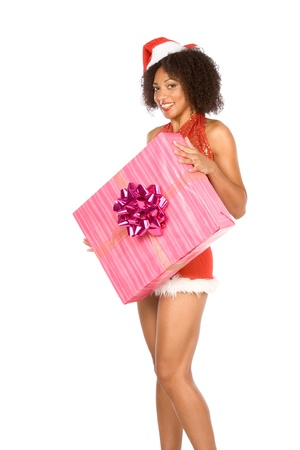 Sexy female in Christmas outfit holding big Christmas gift box