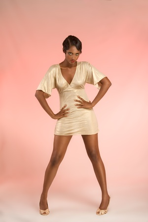 Glamorous retro style (20s) dark skinned female fashion model in sensual teasing flirty manner. photo