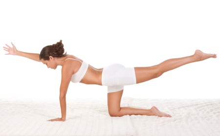 slicked: yoga pose Sunbird - female in sport clothes performing exercise