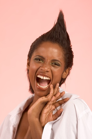 Portrait of mad ethnic mix of Afro-American and Indian female screaming photo