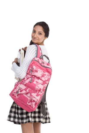 shoulder bag: education series - Friendly ethnic Indian female high school student with backpack and composition book Stock Photo