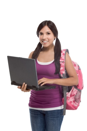 friendly Latina High school student schoolgirl with backpack, holding laptop computer Stok Fotoğraf