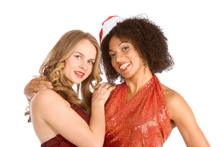 Two lesbian friend lovers female one Caucasian and second ethnic Latina in Mrs. Santa Claus are in friendly hug photo