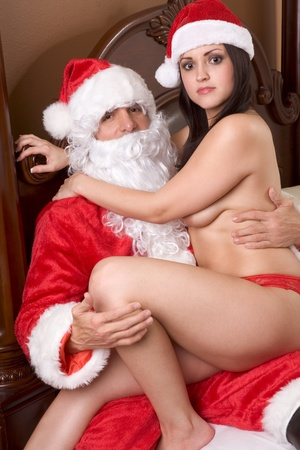 Young sexy woman having sex with Santa Claus Stock Photo - 9498539