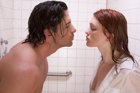Loving affectionate nude young heterosexual couple in affectionate sensual kiss after taking shower. Stock Photo - 9570383