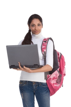 brunnet: ducation series template - Friendly ethnic Indian woman high school student typing on portable computer Stock Photo