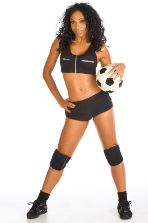 Fitness series - sexy mid aged woman couch in sport clothes with black and white football ball