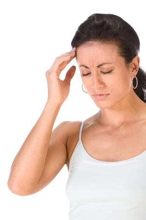emotional pain: Retrato de mujer (etnia mixta) que est� tocando la cabeza a mano y al parecer sufren migra�a severa  Foto de archivo