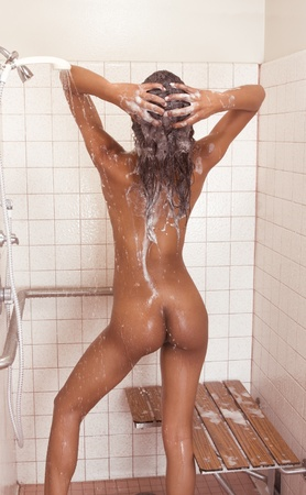 biracial (mix of African-American, German-Jewish, English, Irish, French, and Native American ethnicity) nude female in shower Stock Photo - 9773457