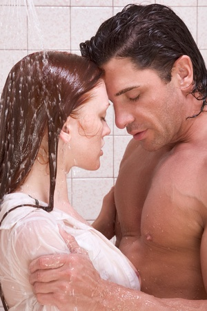 Loving affectionate young heterosexual couple in affectionate sensual kiss after taking shower. Mid adult Caucasian men in late 30s and young Caucasian redhead woman in early 20s Stock Photo - 9773461